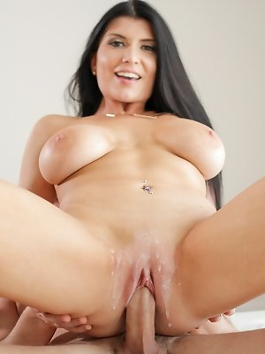 """Busty mature brunette gives her man a """"Welcome Home"""" fuck"""